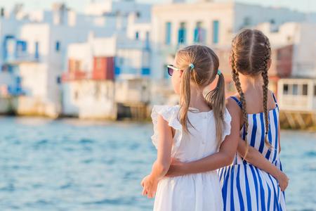 Adorable little girls on vacation on Mykonos island, Greece. Stock Photo