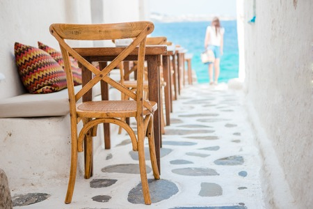 Beautiful typical greek outdoor cafe in Mykonos with amazing sea view on Cyclades islands