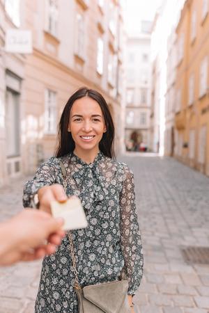 Closeup shot of a woman passing a payment credit card.