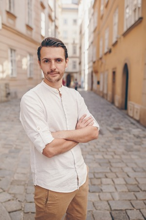 Young man background the old european city take selfie Stock Photo