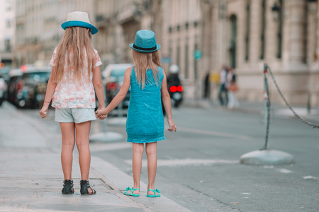 Adorable fashion little girls outdoors in European city Stock Photo
