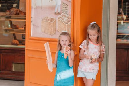 Cutiest kids with fresh crisp baguette in Paris Stock Photo