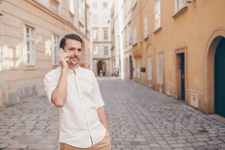 Caucasian tourist boy in European city on vacation Stock Photo