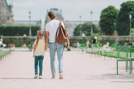 Family in European city, Paris, France. French summer holidays, travel and people concept. Stock Photo