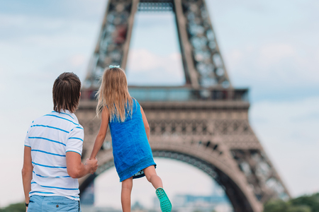 Little cute girl and her father in Paris near Eiffel Tower during summer french vacation Stock Photo