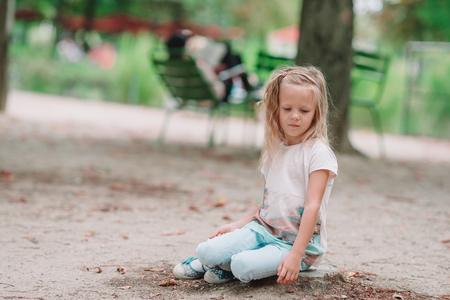 Adorable fashion little girl outdoors in the Tuileries Gardens, Paris