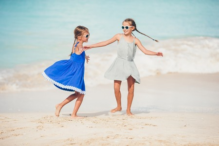 Happy kids running and jumping at beach Stock Photo