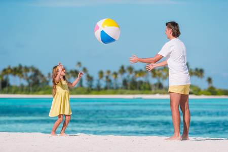 Happy family on the beach with ball having fun together Standard-Bild - 122938504