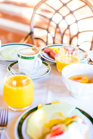 Healthy breakfast with fresh juice and sweet croissant in restaraunt resort outdoor 写真素材