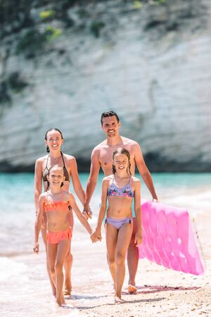Happy beautiful family on white beach having fun together Banque d'images