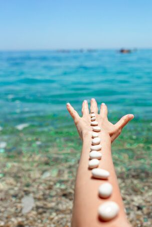 Handful of sea stones on the beach. Conceptual design