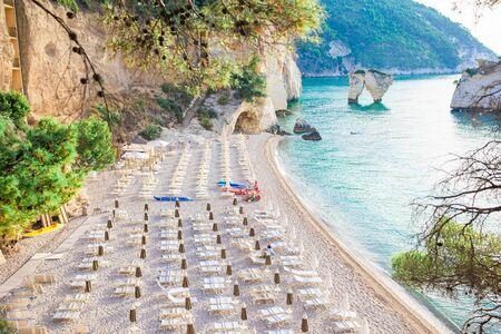Mattinata Faraglioni stacks and beach coast of Mergoli, Vieste Gargano, Apulia, Italy.