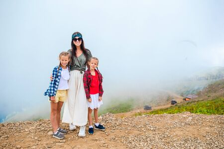 Beautiful happy family in mountains in the background of fog. Beautful landscape