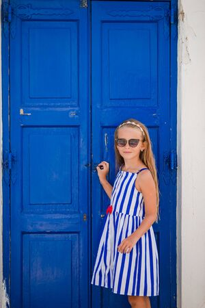 Adorable little girl at old street of typical greek traditional village Reklamní fotografie