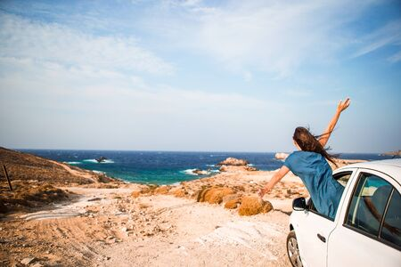 Young woman on vacation travel by car. Reklamní fotografie