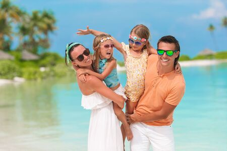 Young family on vacation have a lot of fun Imagens