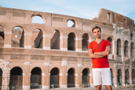 Happy family in Europe. Man in Rome over Coliseum background Banco de Imagens