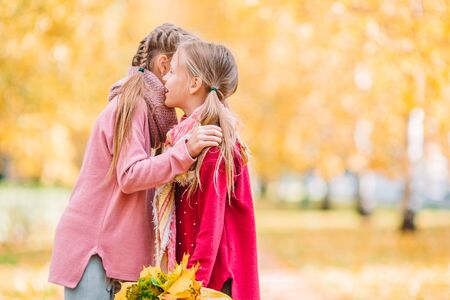 Little adorable girls outdoors at warm sunny autumn day Stock fotó