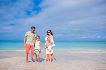 Happy family on the beach at summer vacation Stock Photo