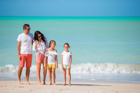 Happy beautiful family with kids on the beach Banque d'images - 133779704
