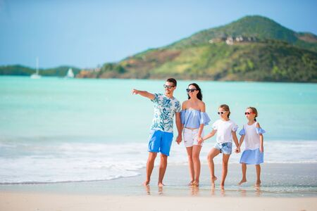 Happy beautiful family with kids on the beach Banque d'images - 133779747
