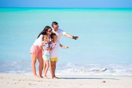 Young family of four on vacation have fun Banque d'images - 133779772