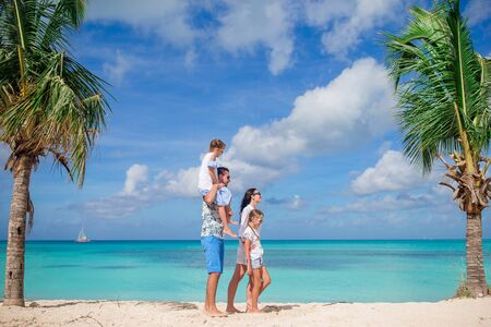 Young family of four on vacation have fun Banque d'images - 133779776