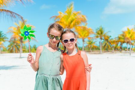 Portrait of two beautiful kids looking at camera background of beautiful nature of blue sky and turquoise sea Banque d'images - 133779795