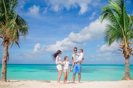 Happy beautiful family with kids on the beach Banque d'images - 133779865