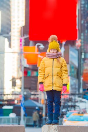 Adorable little girl have fun on Times Square in New York City