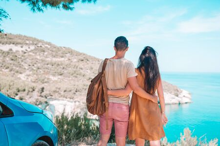 Family on summer vacation background of beautiful San Felice arch Architello on Gargano coast traveling by car