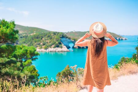 Woman on summer vacation background of beautiful coast in Italy