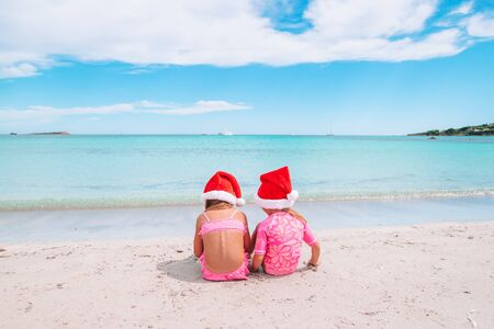 Adorable little girls on Christmas on the beach