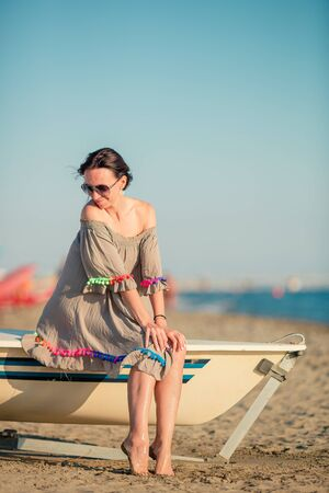 Beautiful woman on the beach in Italy coast