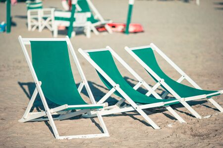 Beach chairs on european beach in popular area Archivio Fotografico