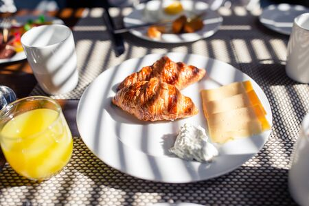 Fresh and delisious breakfast in hotel restaraunt. Delicious tasty croissants and fresh juice for breakfast at outdoor cafe
