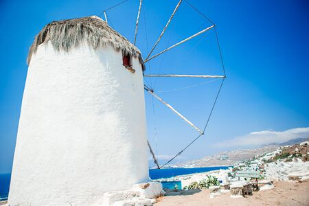 Famous view of old traditional greek windmills on Mykonos island at sunrise, Cyclades, Greece