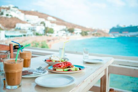 Healthy tasty breakfast on table in outdoor cafe