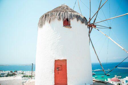 Old traditional greek windmills on Mykonos island at sunrise, Cyclades, Greece