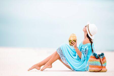 Young beautiful woman having fun on tropical seashore. Stock Photo