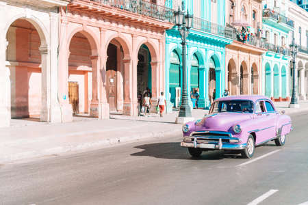 View of yellow classic vintage car in Old Havana, Cuba Editorial