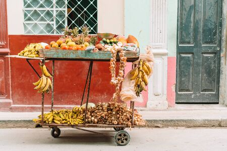 Small cart of fruits and vegetables on the street of Old Havana area for sale.