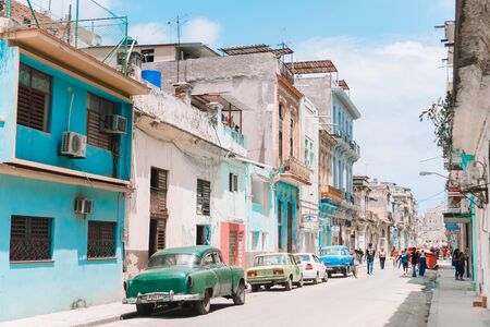 HAVANA, CUBA - APRIL 14, 2017: Authentic view of a street of Old Havana with old buildings and cars Standard-Bild