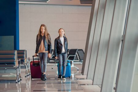 Kids in airport going on boarding together at international airport
