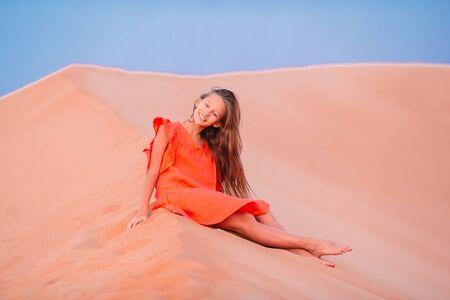 Girl among dunes in Rub al-Khali desert in United Arab Emirates Stok Fotoğraf