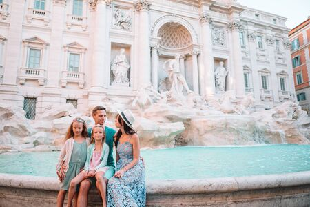 Happy young parents and little kids smiling traveling together on european travel vacation holiday in Europe