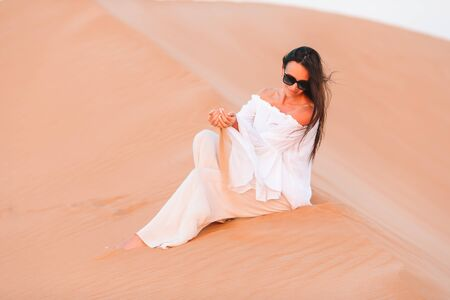 Beautiful woman in dunes in the most big desert in the world Banque d'images