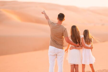 Father and his kids in beautiful landscape of desert