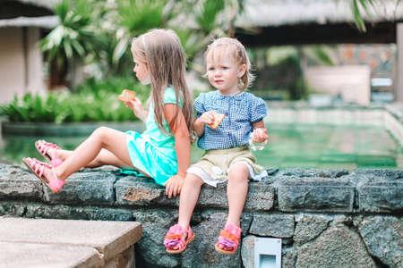 Adorable little girls during summer vacation in their villa Reklamní fotografie