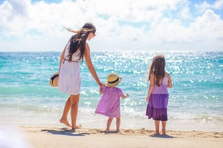 Family of mother and kids on the beach vacation Imagens